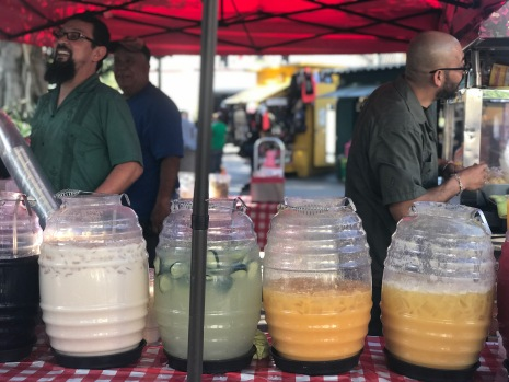 ¡Aguas, Aguas frescas! Mexican vendors selling the typical fresh waters of different flavors: cucumber, horchata, lemon, guanabana and mango.